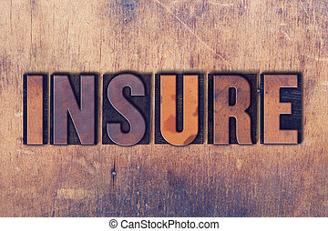 Insure Theme Letterpress Word on Wood Background - The word...