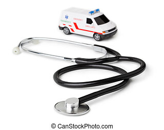 Stethoscope and toy ambulance car isolated on white...
