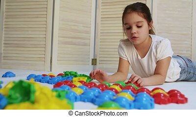 Children playing with puzzle - Girl play at home, laughing...