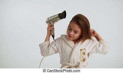 Girl combing and dry hair at white background