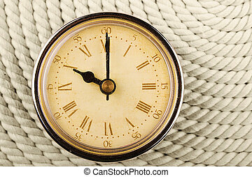 Clock with Roman numerals on cord background 10