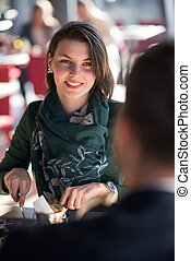 Closeup shot of young woman and man having meal. - Loving...
