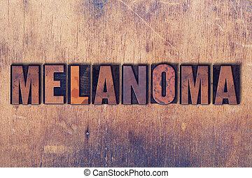 Melanoma Theme Letterpress Word on Wood Background - The...