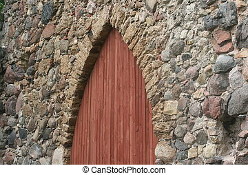 wooden doors in ancient castle wall