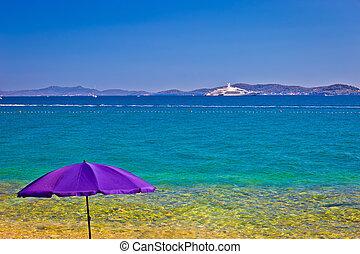 Adriatic beach in Zadar with megayacht background, Dalmatia,...