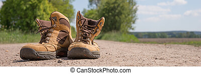 Hiking boots on a dirt road