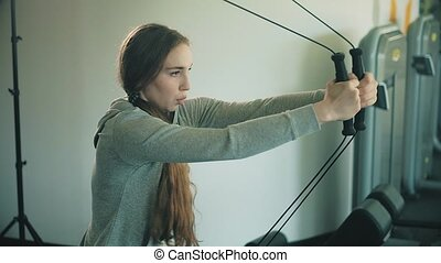 Woman working out lifting weights 4k - Woman working out...