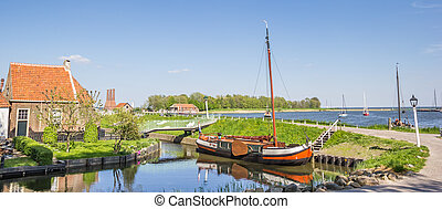 Panorama of a sailing ship at a dike in Enkhuizen,...