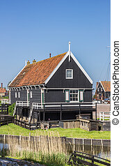 Wooden cottage at the lake in Enkhuizen, Holland