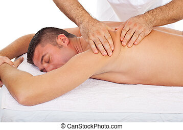 Masseur kneading man back at massage - Professional masseur...