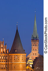 Holstein gate and Petri church by night in Lubeck, Germany
