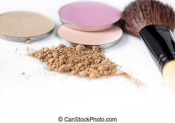 beige powder for face, eye shadow and makeup brush on white...