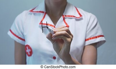 Heart attack, Female doctor writing on transparent screen -...