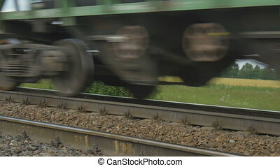 The freight train goes on rails. - The freight train goes on...