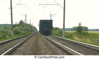Train cars leave far away - The freight train goes on rails....