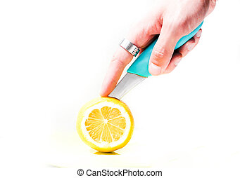 Sour lemon cut with a knife for making juice