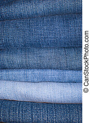 Jeans Background - Stack of Jeans Trousers in Different...