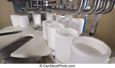 Production materials being treated at a factory. - The...