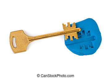 Key impression - security concept isolated on white...
