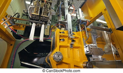 Manufacturing of plastic containers at a plant. - The...