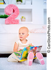 two year old girl - Cute two year old girl playing at home...