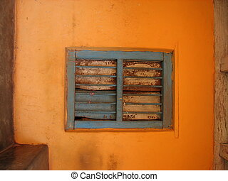 old window with terra-cotta tiled roof. An architectural...