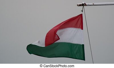 Hungarian flag in strong wind