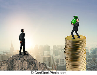 Wealth, income and finance concept - Businessman on mountain...