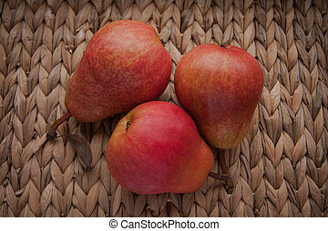 juicy red pear on a wicker background