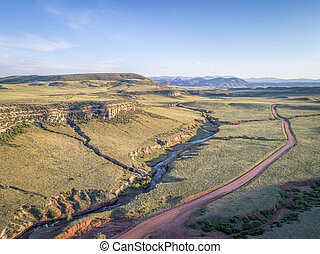 northern Colorado foothills aerial view - dirt road and...