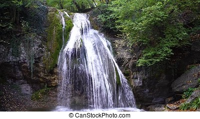 Waterfall in forest. Beautiful view of the waterfall in the...