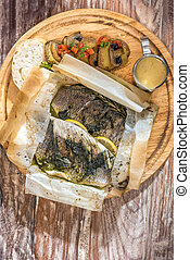 baked sea bass served with grilled vegetable and mushroom