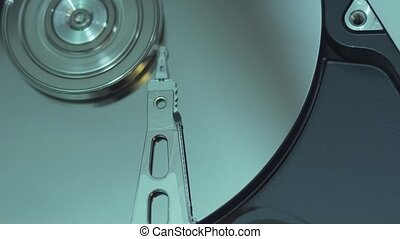 Operating hard disk drive on dark background.