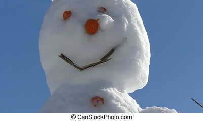 Snowman blue sunny sky - Zoom out smiling snowman