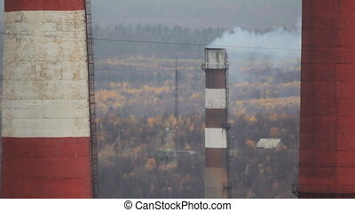 Smoke from factory chimneys - Pollution of atmosphere...