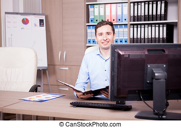 Businessman in office with a folder in hands. Business and...