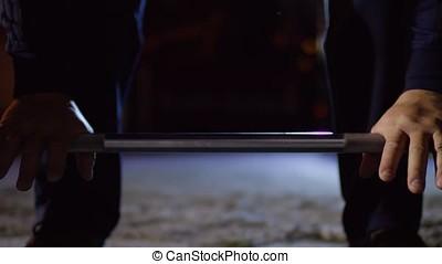 Closeup of muscular man doing deadlift exercise at sport...