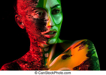 Portrait of woman with Extreme fashion make up in red and...