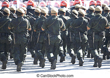 Armed Police Marching - Image of armed uniformed police...