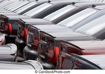 Stockyard Motorcars - A row of brand new motorcars at a...