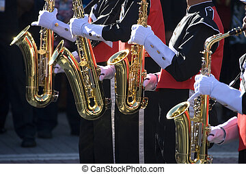 Saxaphones - Image of four gleaming saxaphones used by a...