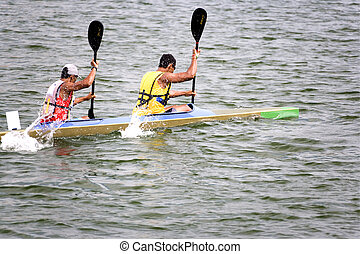 Canoeing - Image of canoeing competitors in action.