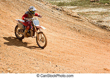 Motocross - Image of a motocross participant in action.