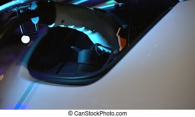 Charging of an electric car, close-up - Charging of an...