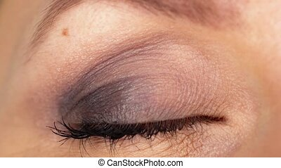 Macro Close-up eye blinking. Slow motion - Beautiful female...