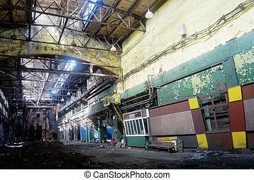 abandoned industrial dirty workshop in natural lighting