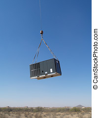Floating in the air - A massive air conditioner compressor...