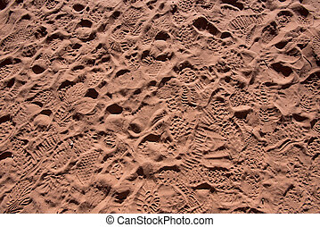 Sandy Footprints of Tourists across a large patch of dirt