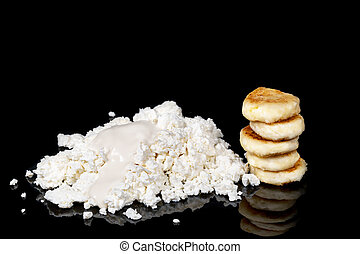 Cheesecakes of cottage cheese with sour cream - Pile of...