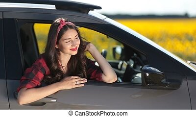 Joyful brunette woman on car summer roadtrip